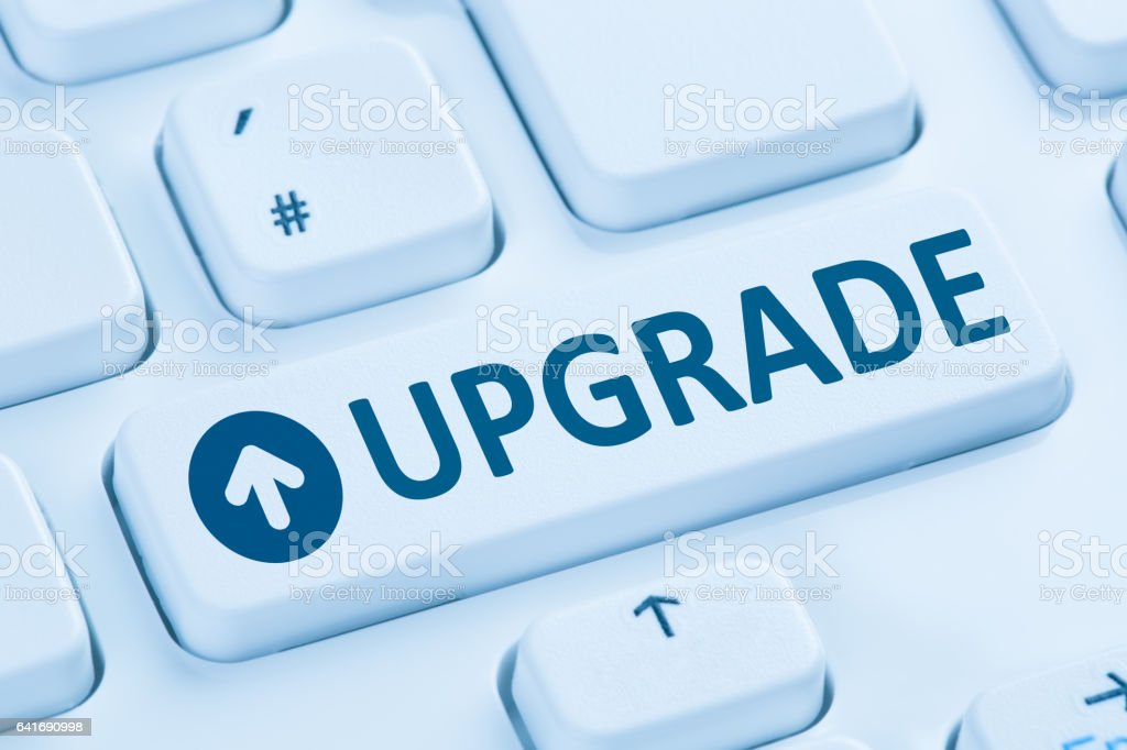 Upgrade upgrading software program blue computer keyboard stock photo