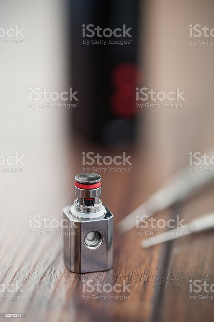 Upgrading e-cig vaporizer with kanthal coil stock photo