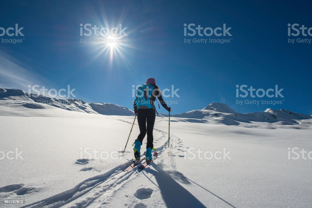 Uphill girl with seal skins and ski mountaineering Uphill girl with seal skins and ski mountaineering Uphill girl with seal skins and ski mountaineering Uphill girl with seal skins and ski mountaineering Uphill girl with seal skins and ski mountaineering stock photo