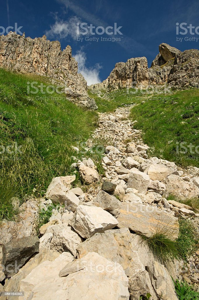 uphill stony path stock photo