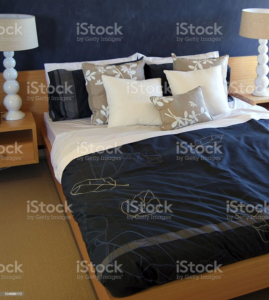 Upmarket bedroom setting in blue royalty-free stock photo