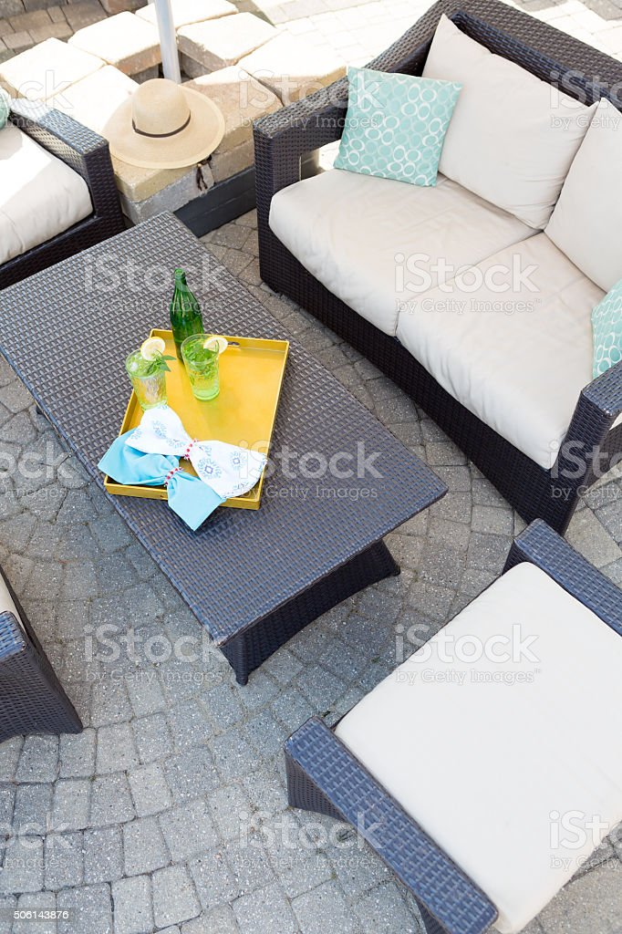 Upmarket outdoor patio with garden furniture stock photo