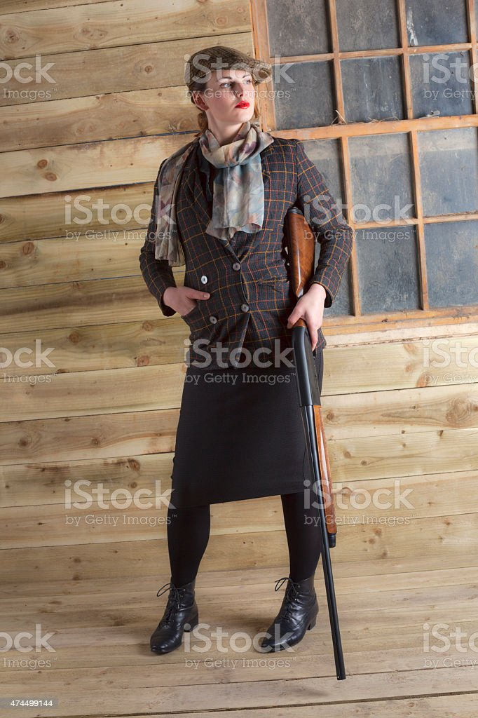 Upper Class Young Lady Dressed For A Shooting Party stock photo