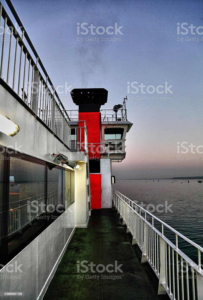 upper deck on ferry at dusk stock photo