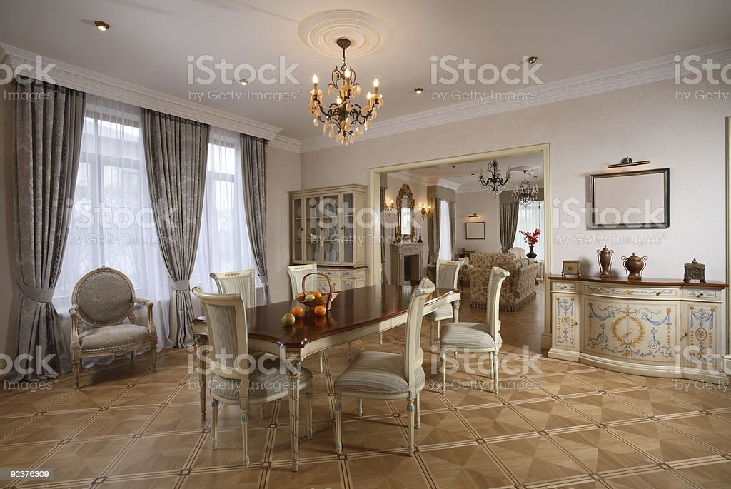 Upper echelon dining area with neutral design colors stock photo