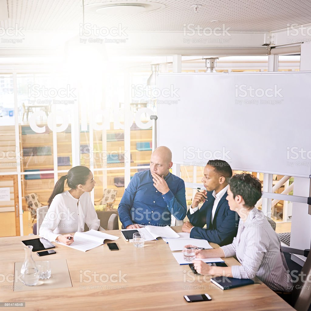 Upper management discussing stratergy at their weekly sunrise meeting stock photo