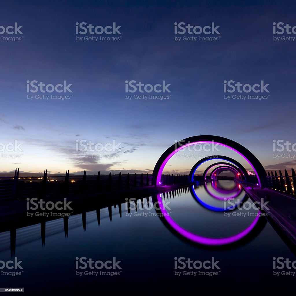 Upper section of Falkirk Wheel at night. stock photo
