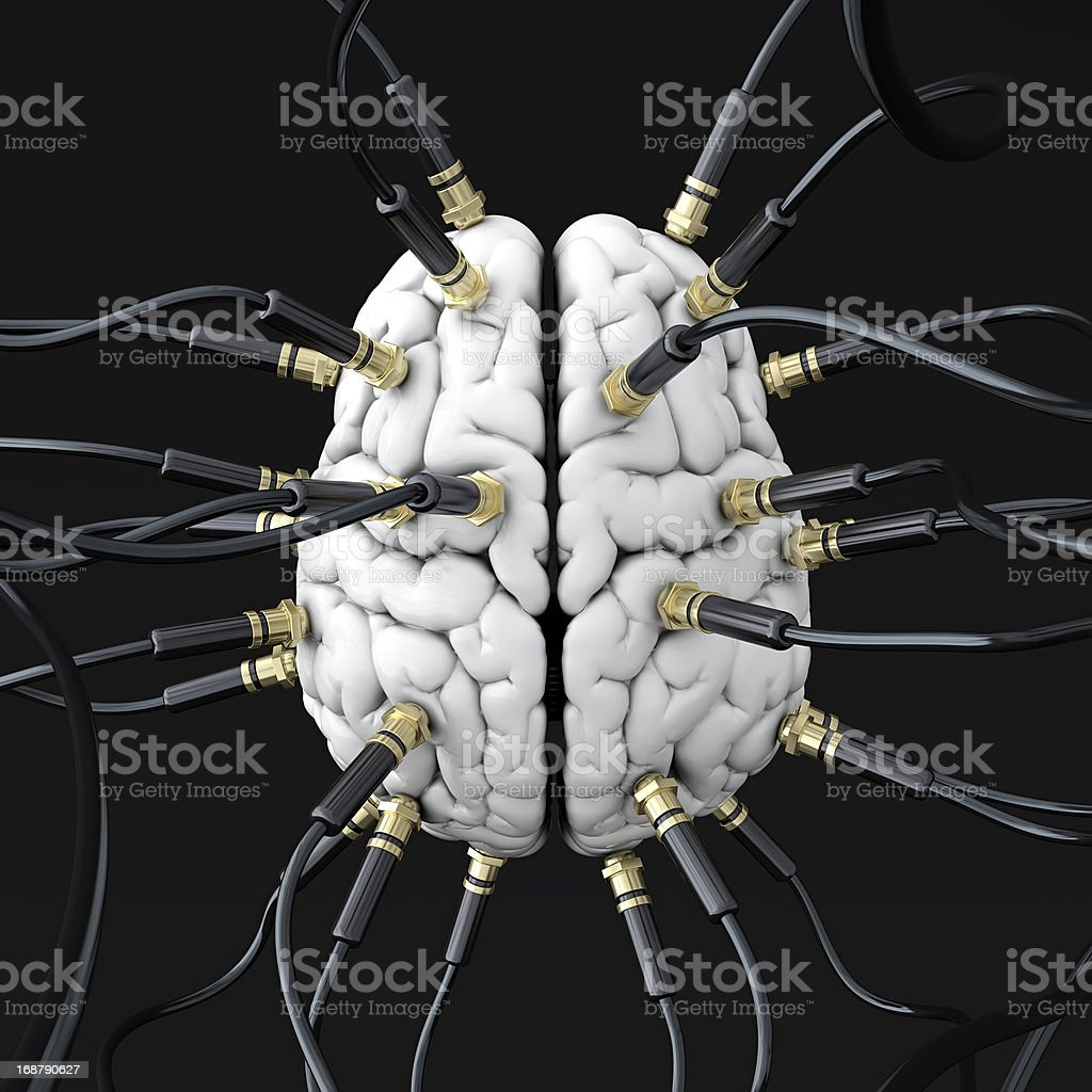 Upper view of several black wires connected to a white brain stock photo