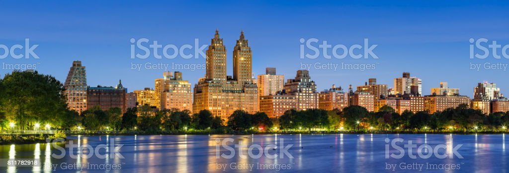 Upper West Side buildings at dawn and Central Park Reservoir. New York City stock photo
