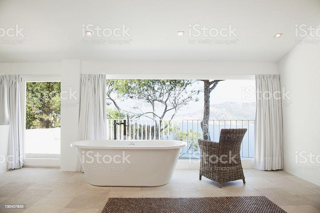 Upright bathtub in modern bathroom stock photo