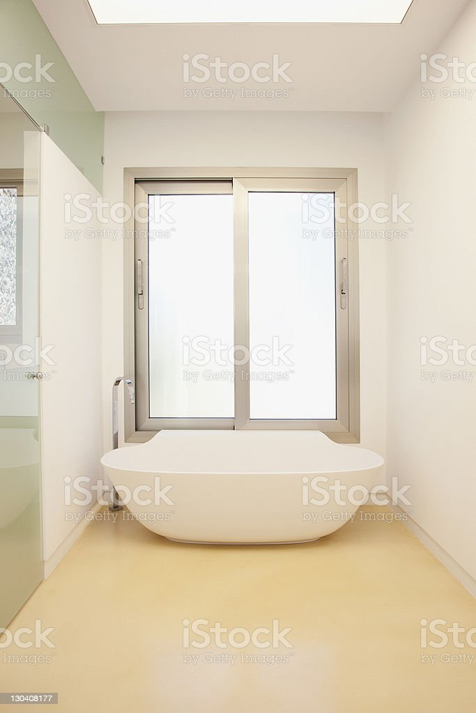 Upright bathtub in modern bathroom royalty-free stock photo