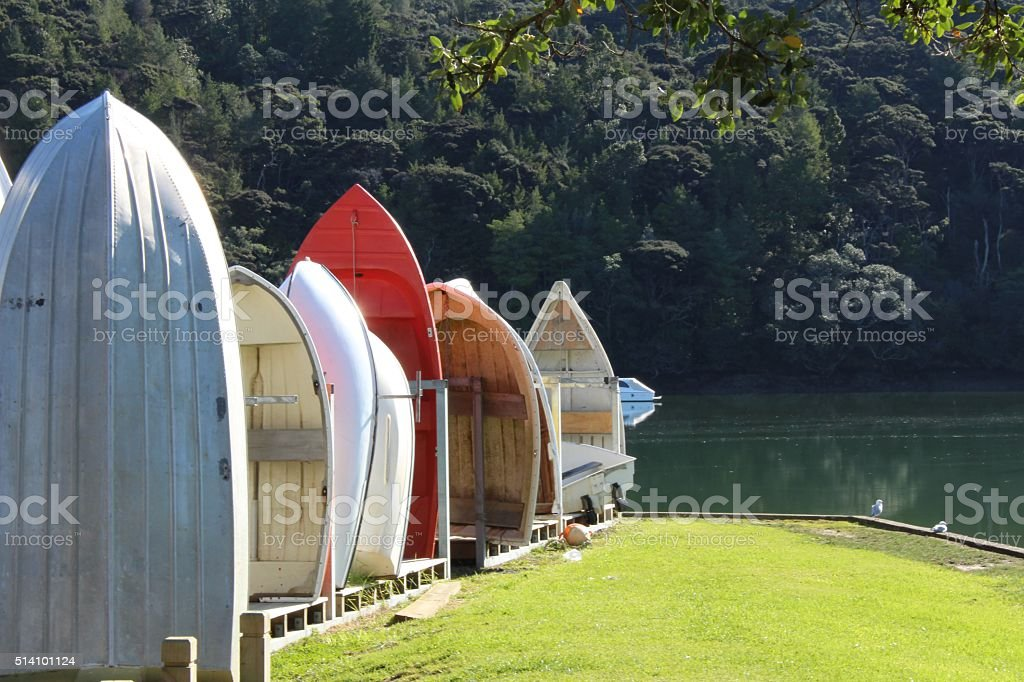 Upright row boats at the river side stock photo