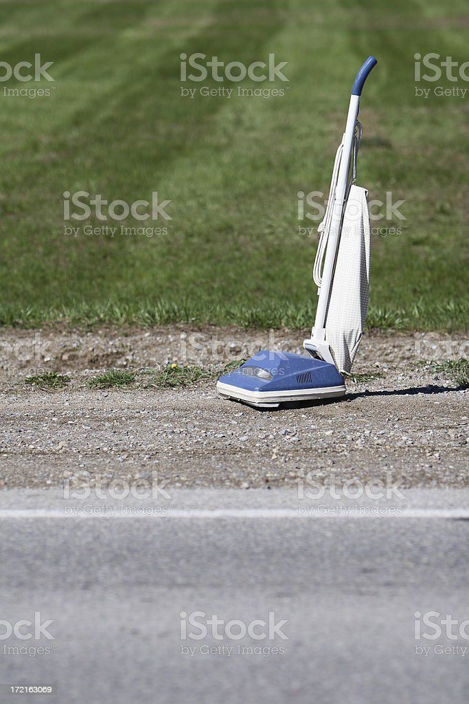 Upright Vaccuum On Roadside royalty-free stock photo