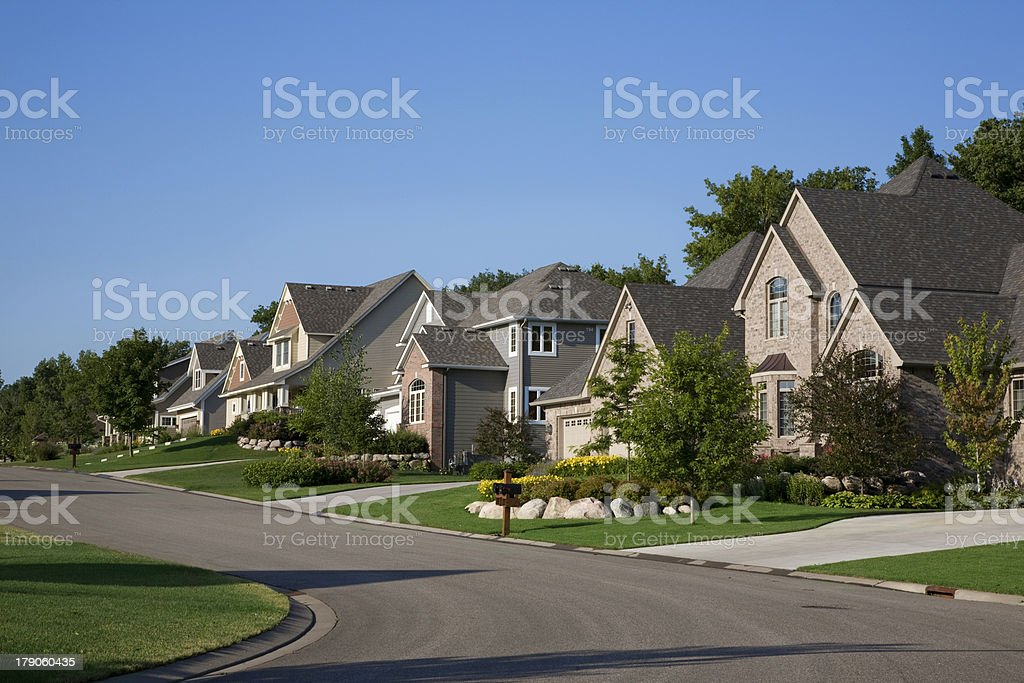 Upscale houses on suburban street stock photo