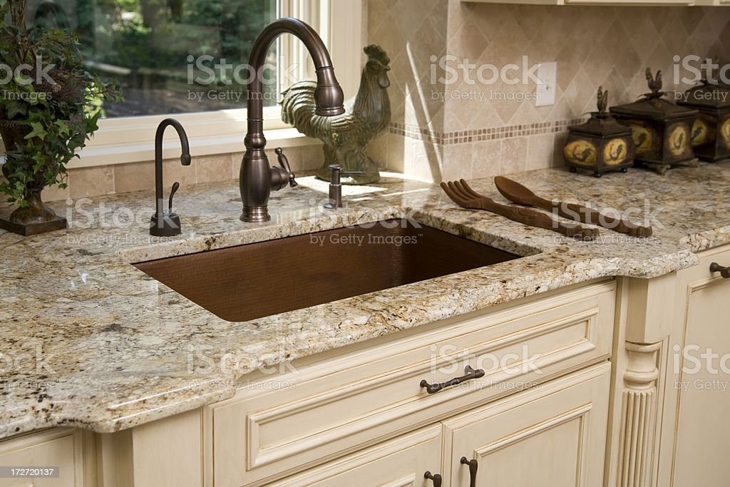 Upscale kitchen sink and countertop. stock photo