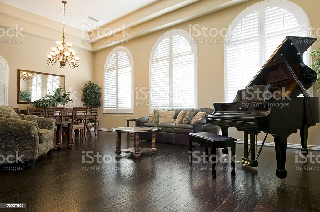 Upscale Living Room With Piano stock photo