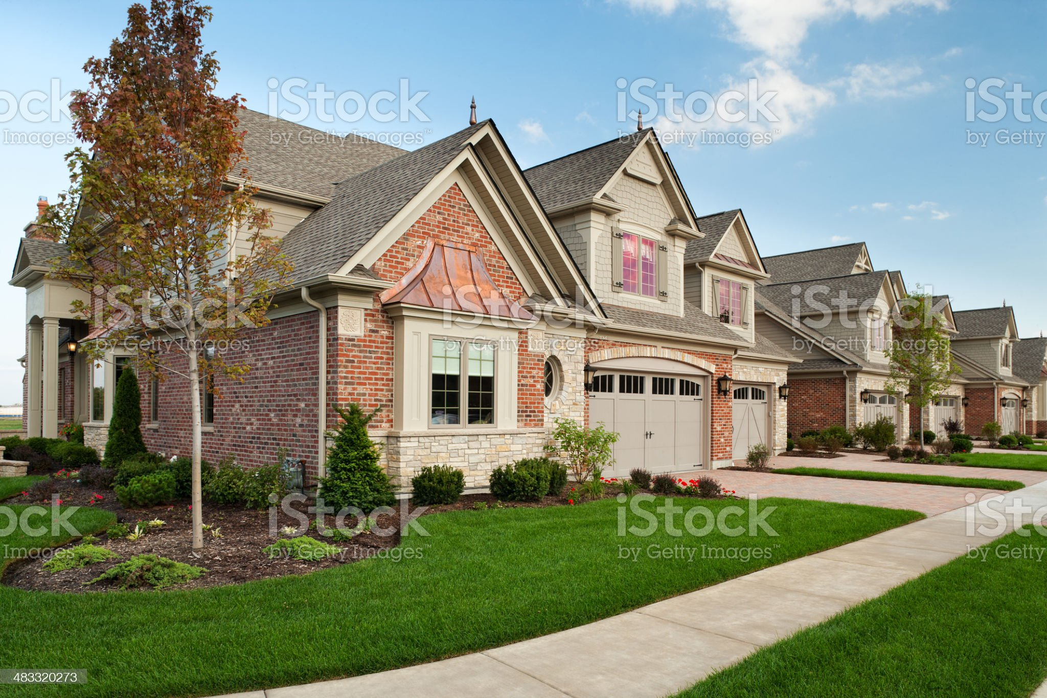 Upscale town homes set against a clear blue sky royalty-free stock photo