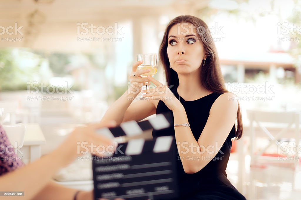 Upset Actress Holding a Glass in Movie Scene stock photo