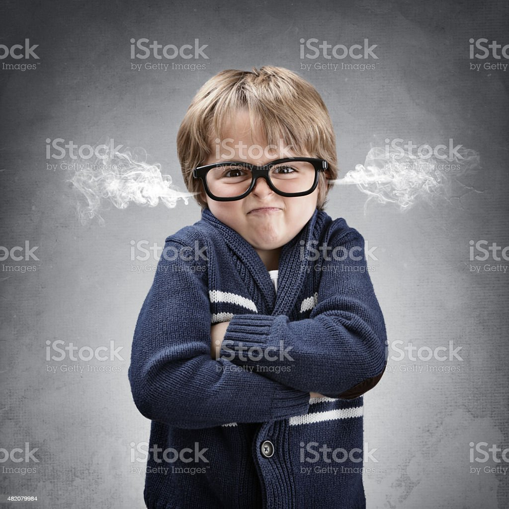 Upset and angry boy venting steam from his ears stock photo