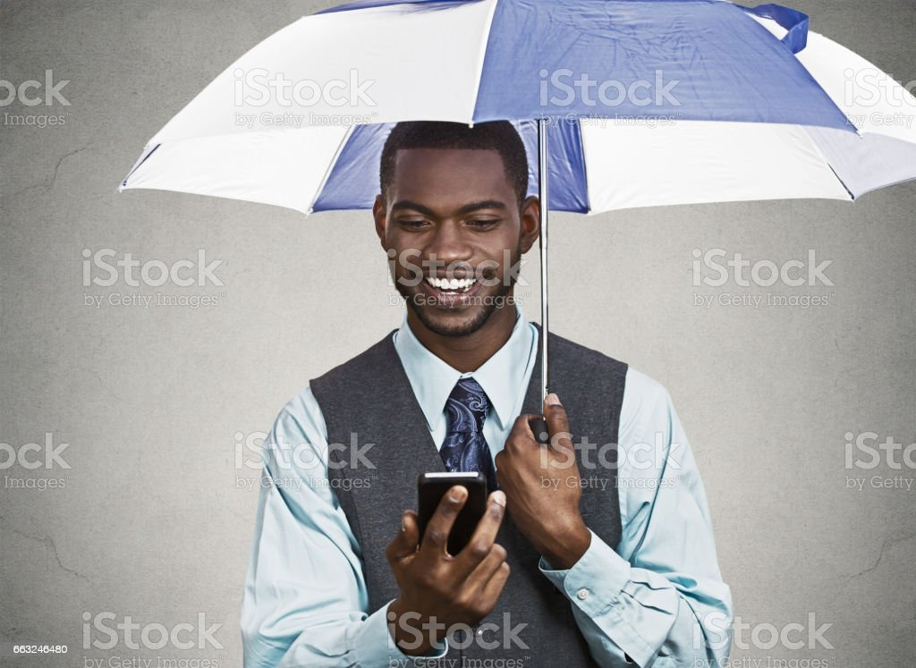 upset, angry business man, funny looking corporate executive reading e-mail on smart phone stock photo