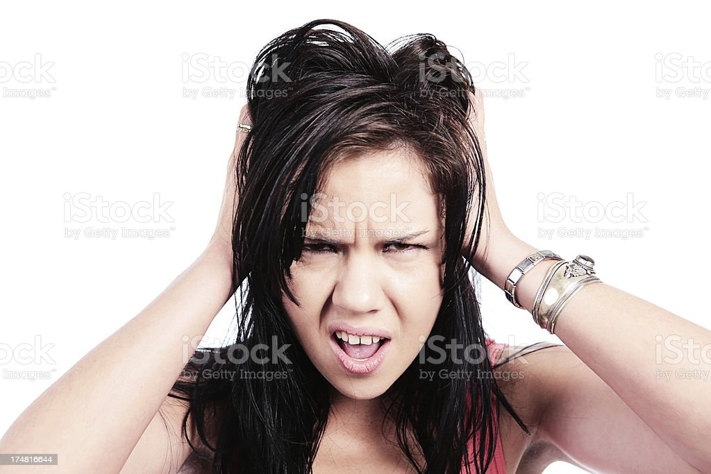 Upset brunette tearing her hair out in frustration royalty-free stock photo