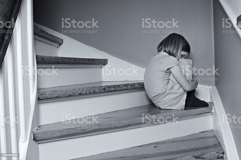 Upset Bullied Schoolgirl Crying At Home stock photo