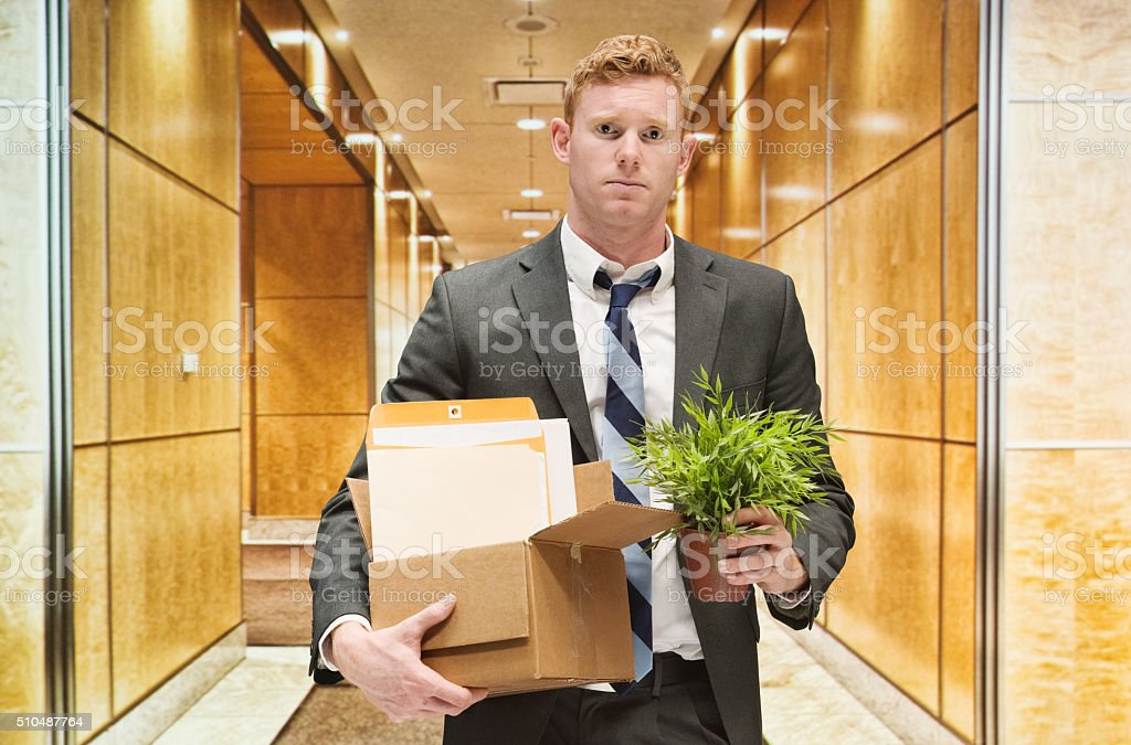 Upset businessman fired from his job stock photo
