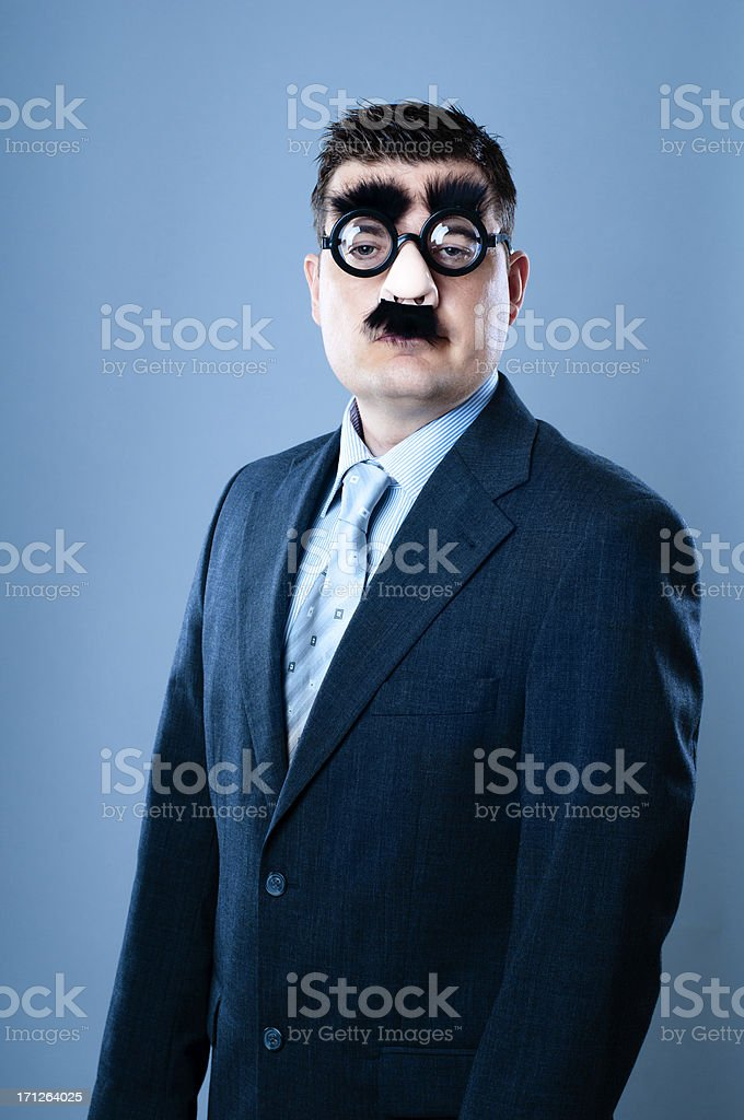 Upset businessman in disguise stock photo