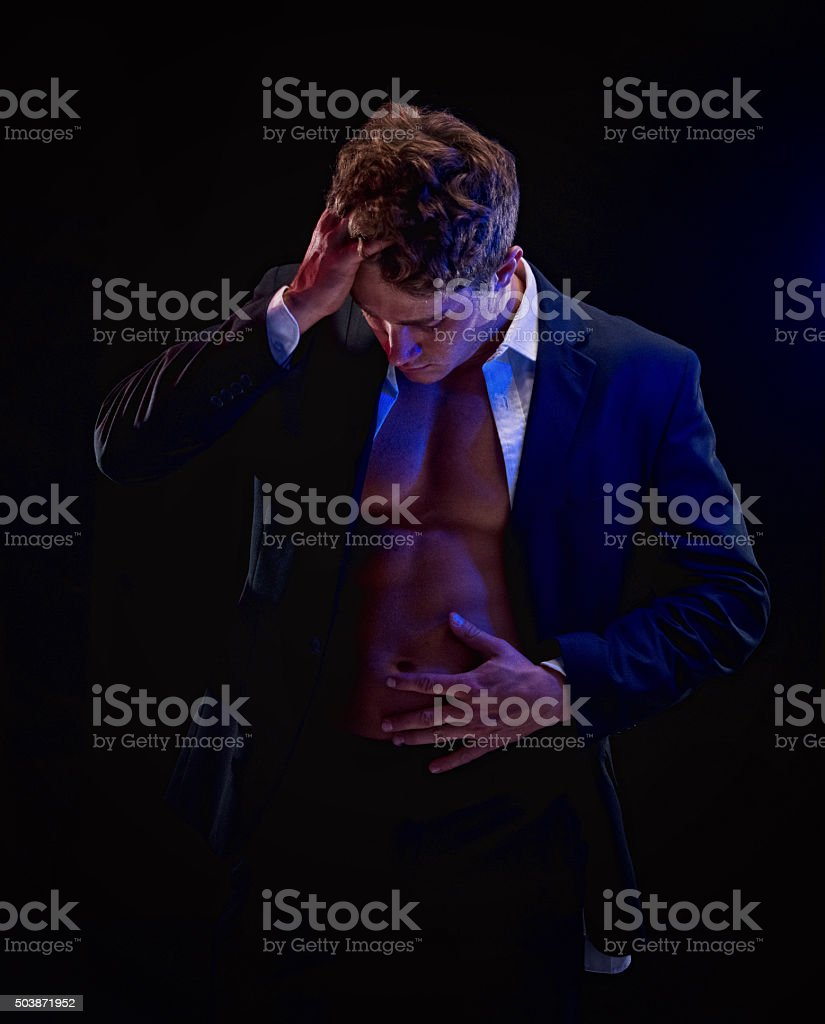 Upset businessman looking down stock photo
