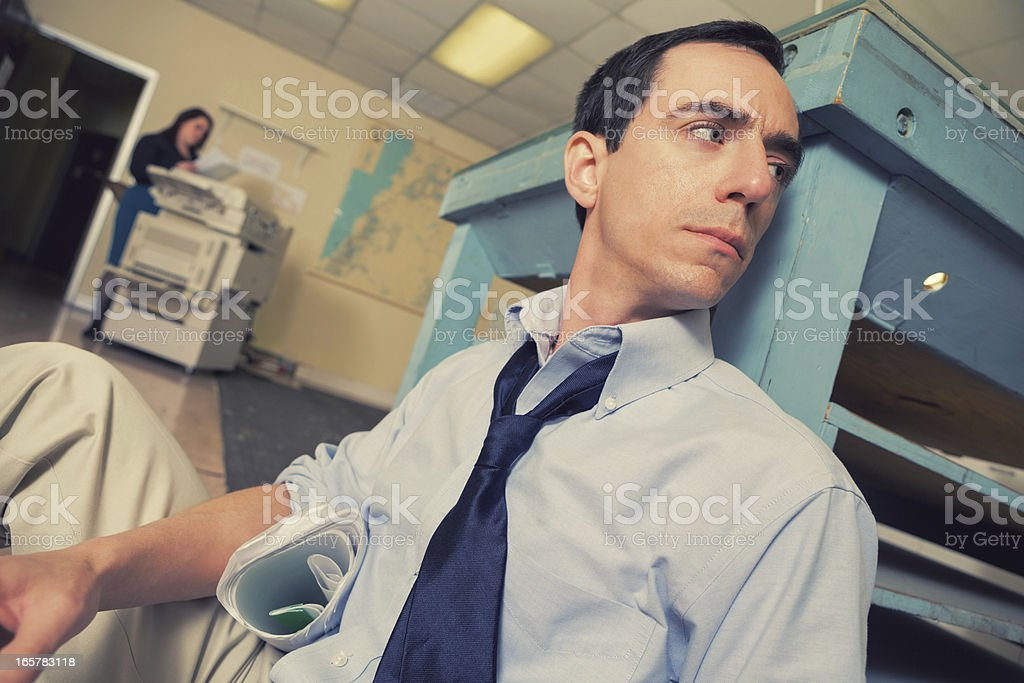 Upset businessman or architect looking away at the office royalty-free stock photo