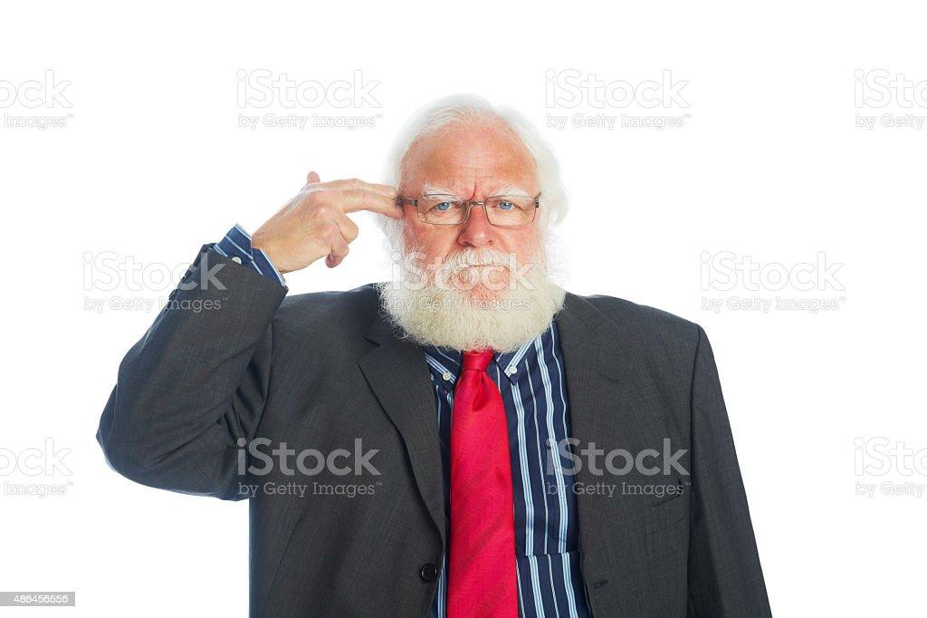 Upset businessman pretending to blow up his head stock photo