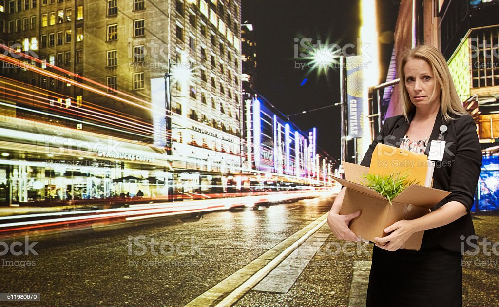 Upset businesswoman fired from her job stock photo