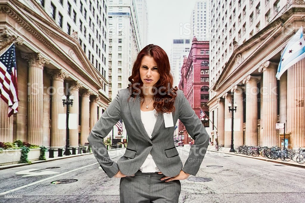 Upset businesswoman standing outdoors stock photo
