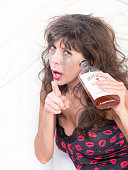 Upset Drunk Woman with Whiskey Bottle in Bedroom