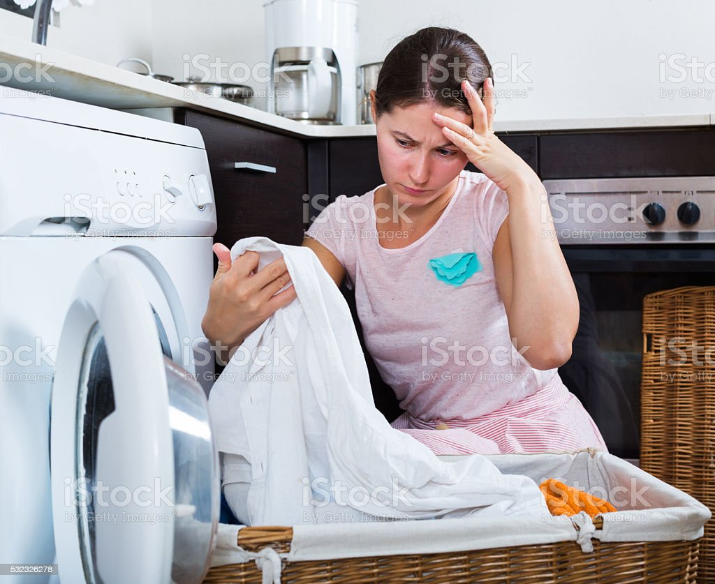 Upset housewife cannot wash stains stock photo