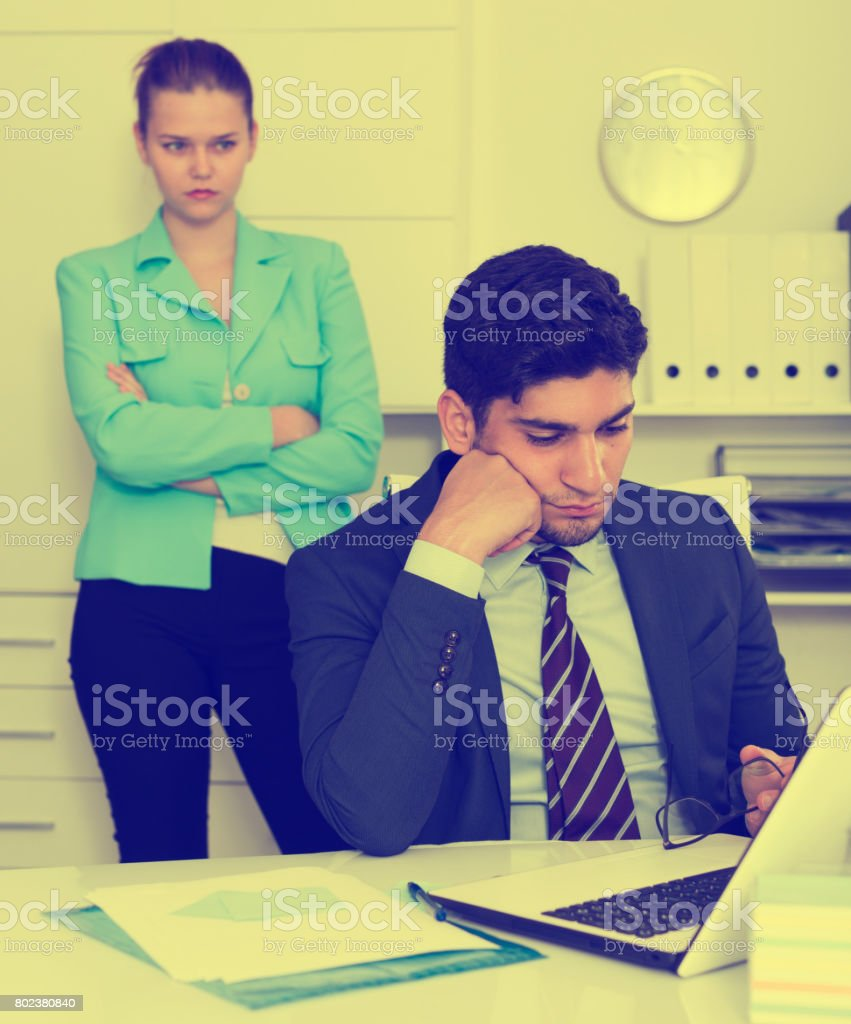 Upset man with disgruntled boss stock photo