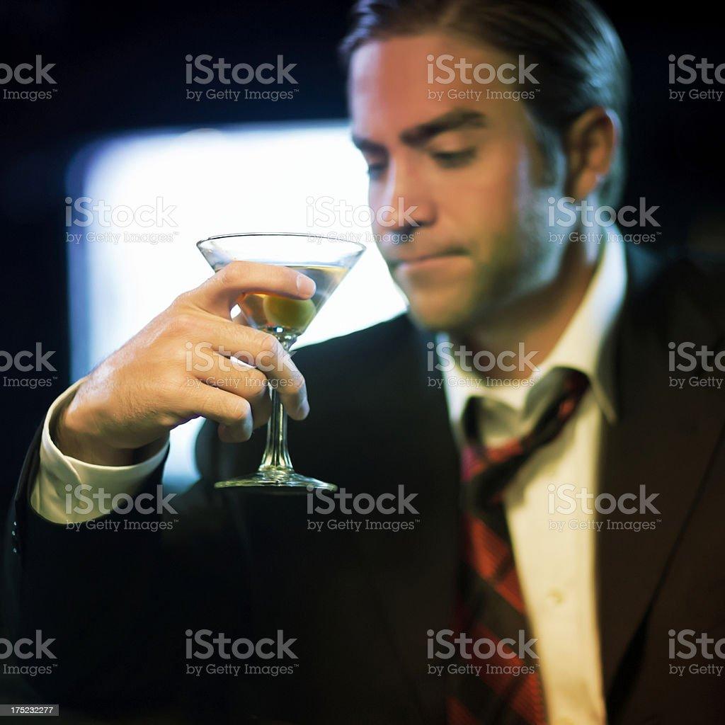 Upset Man With Martini Glass At Bar. royalty-free stock photo