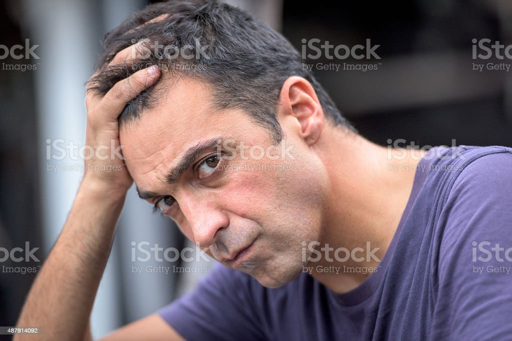 Upset Mid adult man stock photo