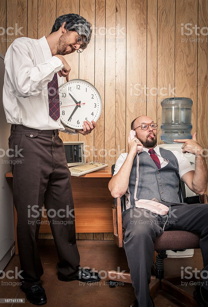 Upset retro office manager yelling at late employee with clock royalty-free stock photo