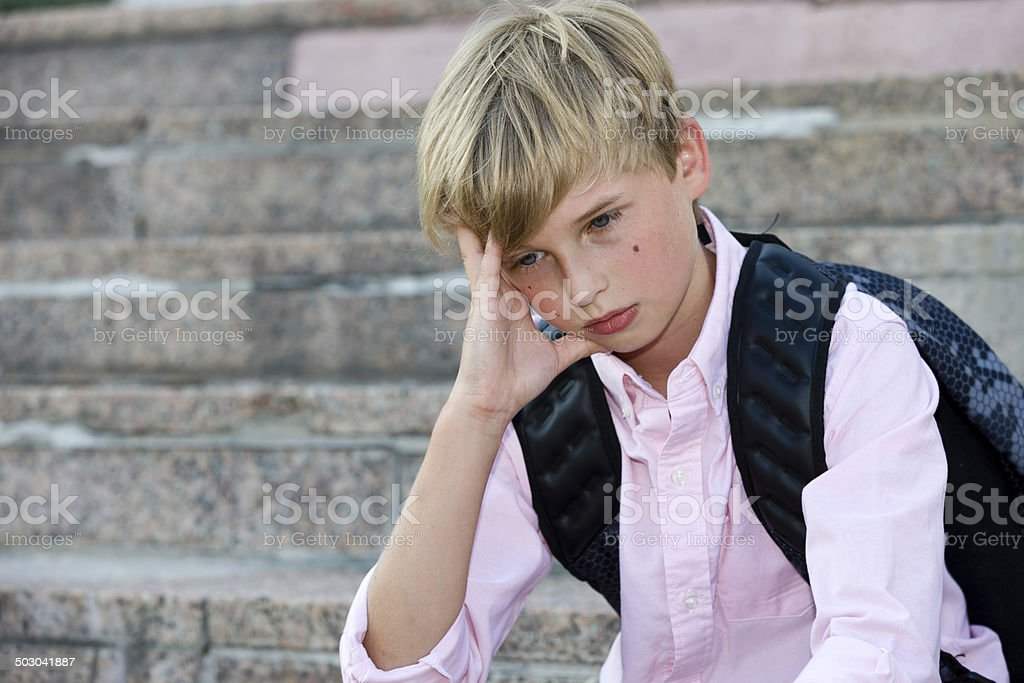 Upset schoolboy stock photo