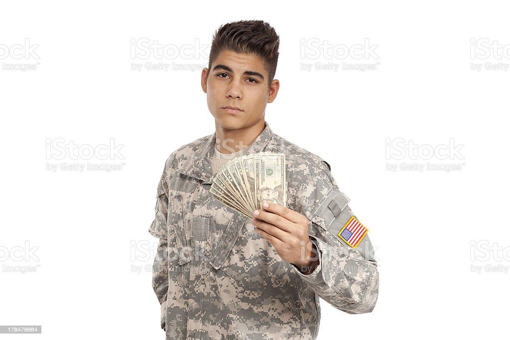Upset serviceman holds money stock photo