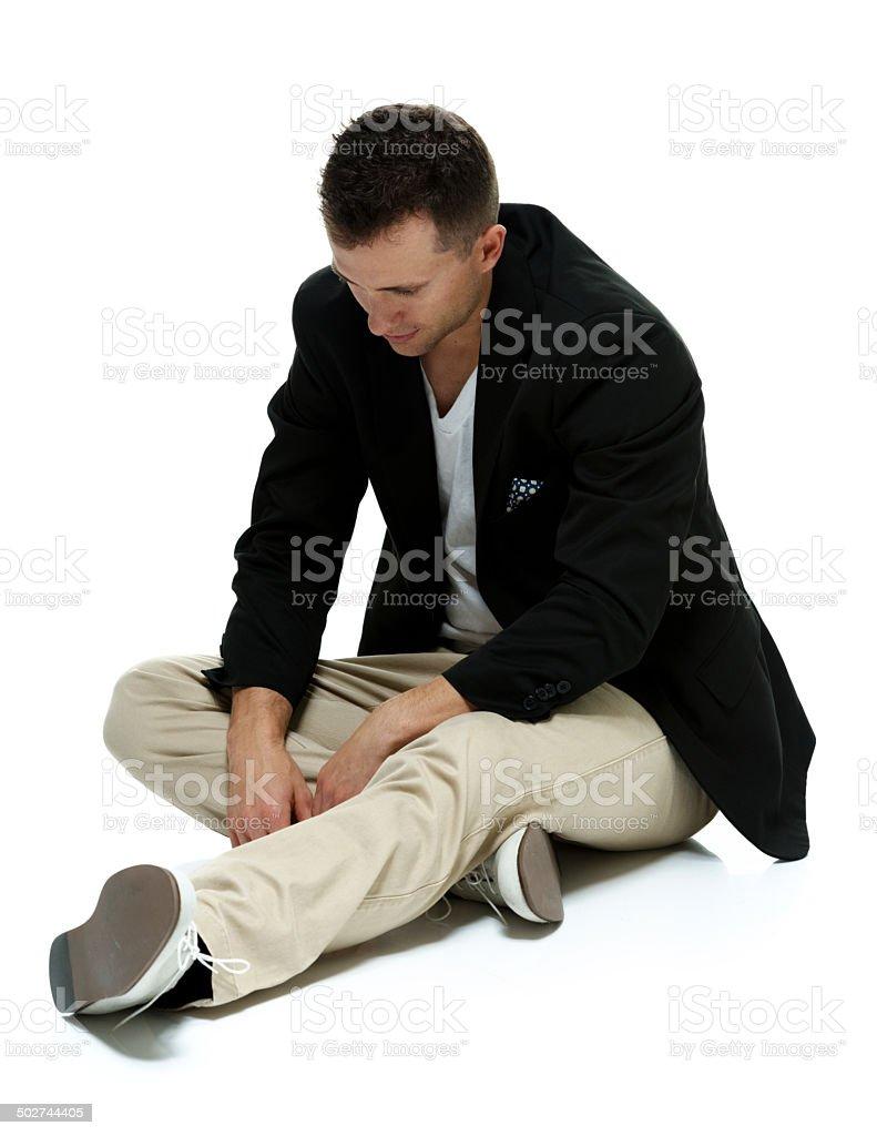 Upset smart casual man sitting on floor royalty-free stock photo