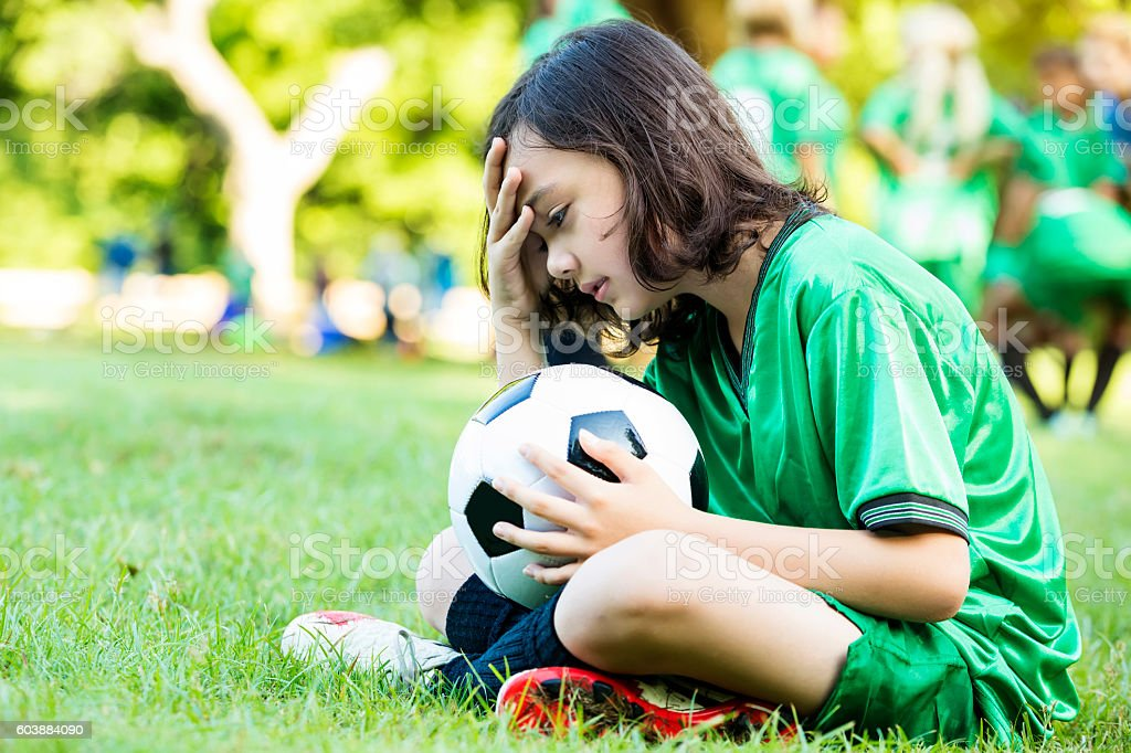 Upset soccer player after game loss stock photo