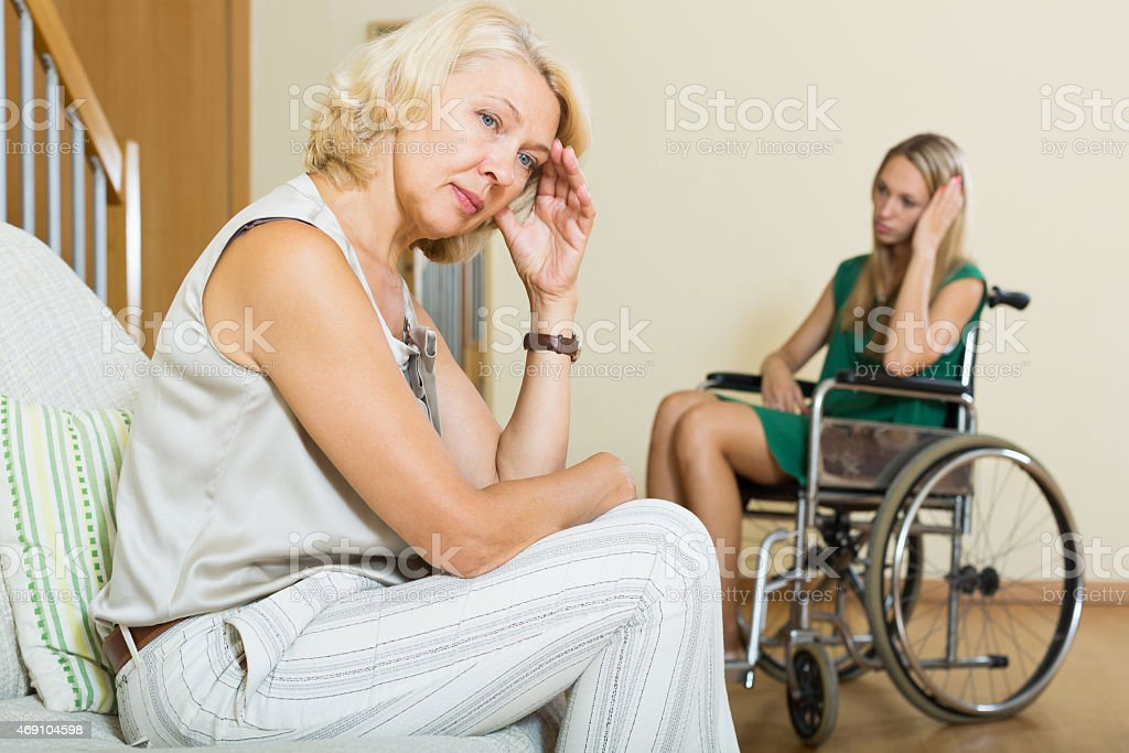 Upset woman and handicapped stock photo