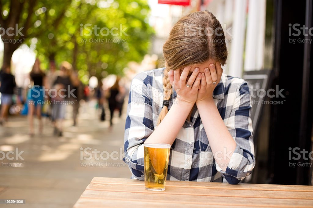 upset woman at the bar royalty-free stock photo