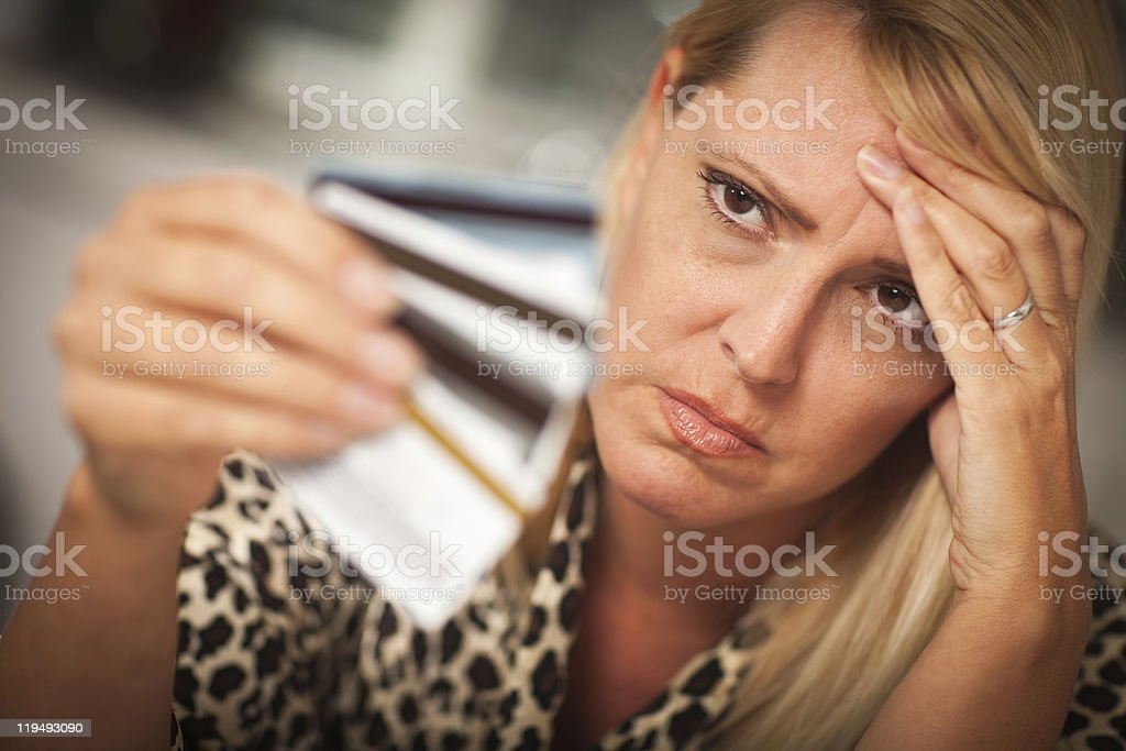 Upset Woman Glaring At Her Many Credit Cards royalty-free stock photo