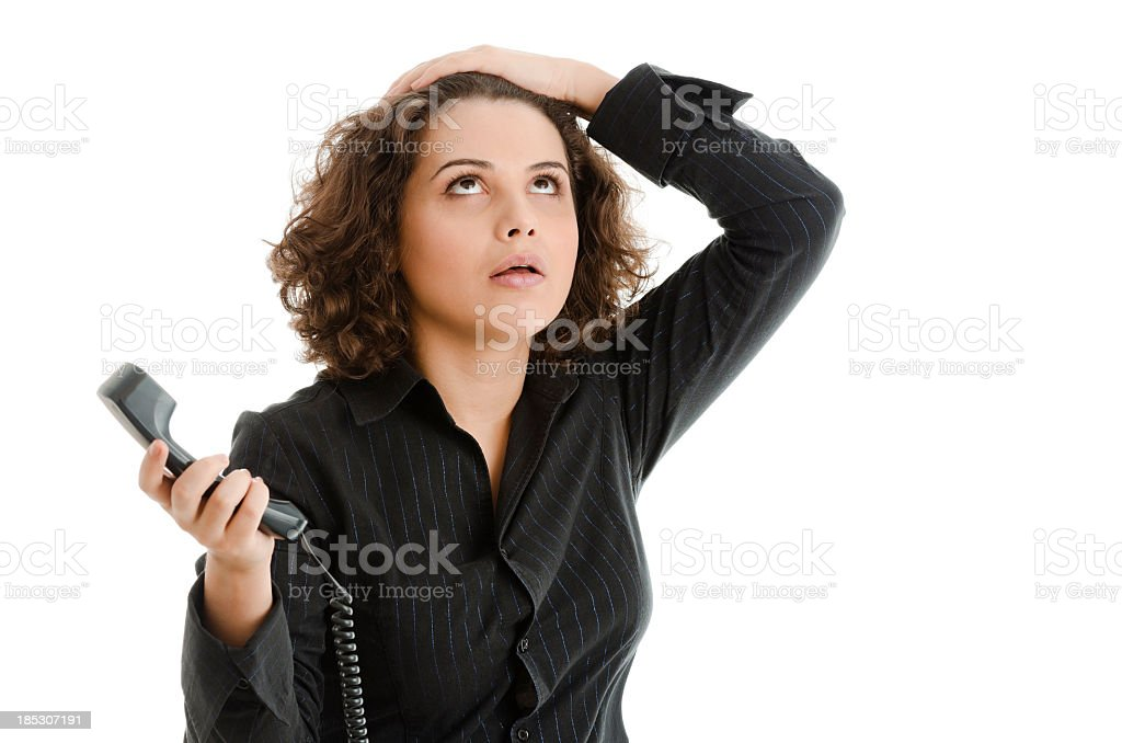 Upset woman with phone in her hand, looking up, isolated royalty-free stock photo