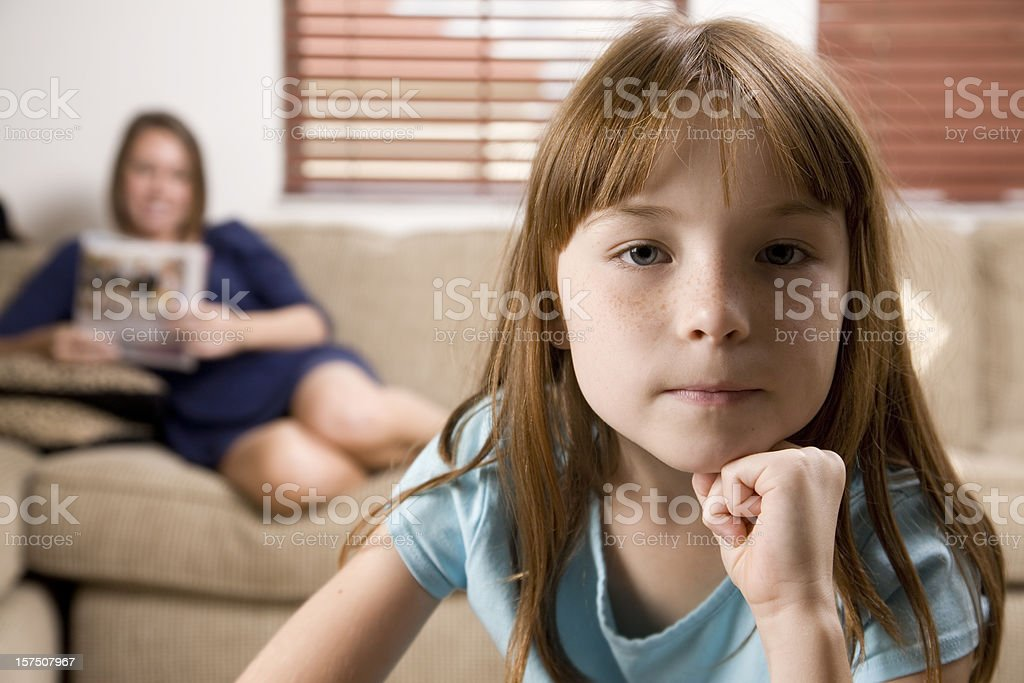 Upset Young Girl at Home with Mom Relaxing royalty-free stock photo