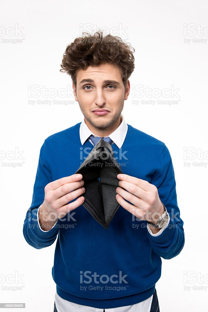 Upset young man holding emty wallet stock photo
