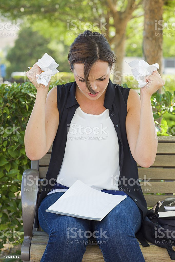 Upset Young Woman with Pencil and Crumpled Paper in Hands royalty-free stock photo
